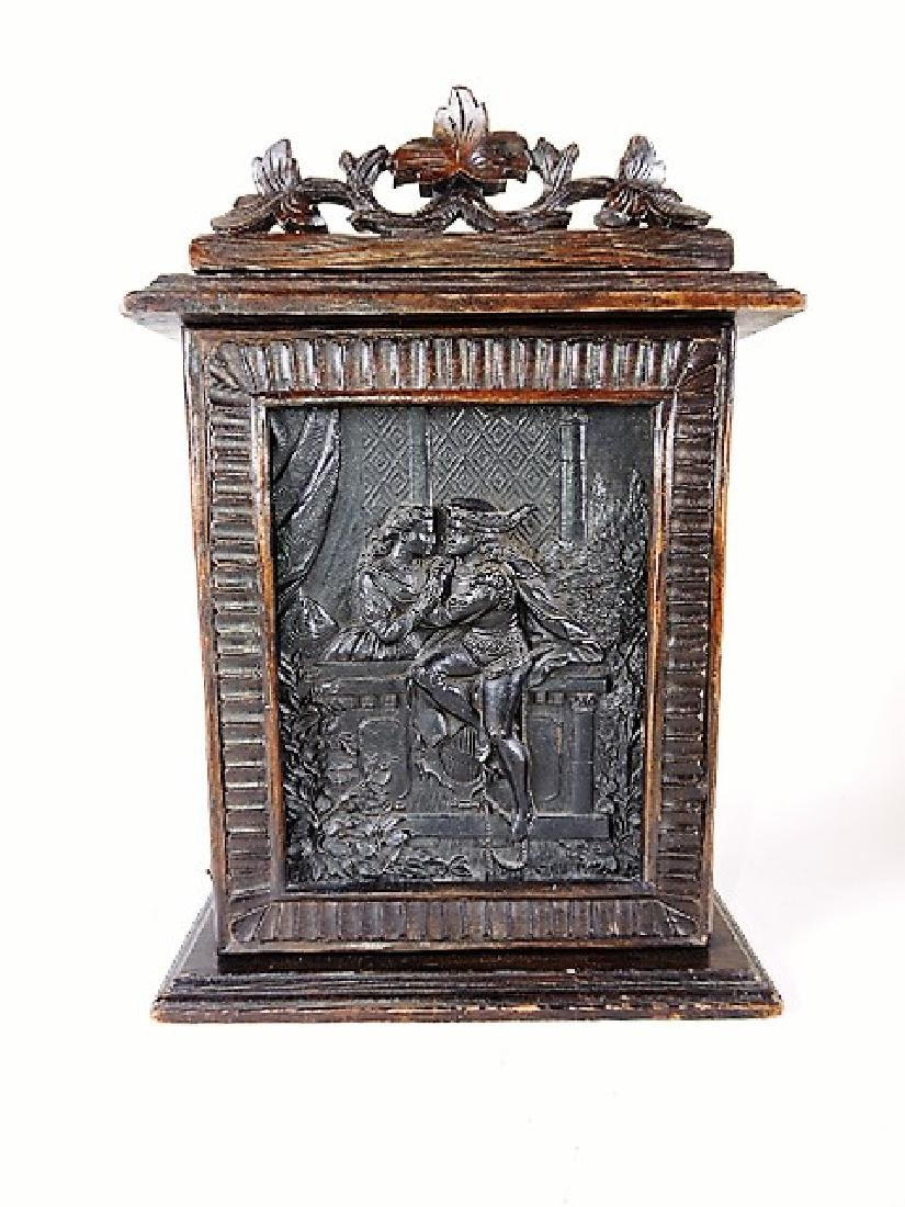 Black Forest carved wooden wall cabinet with romantic