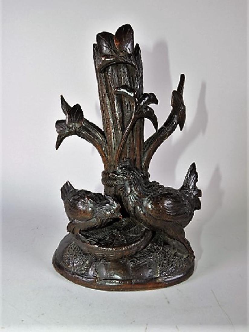 Black Forest carved wooden vase/candle holder with