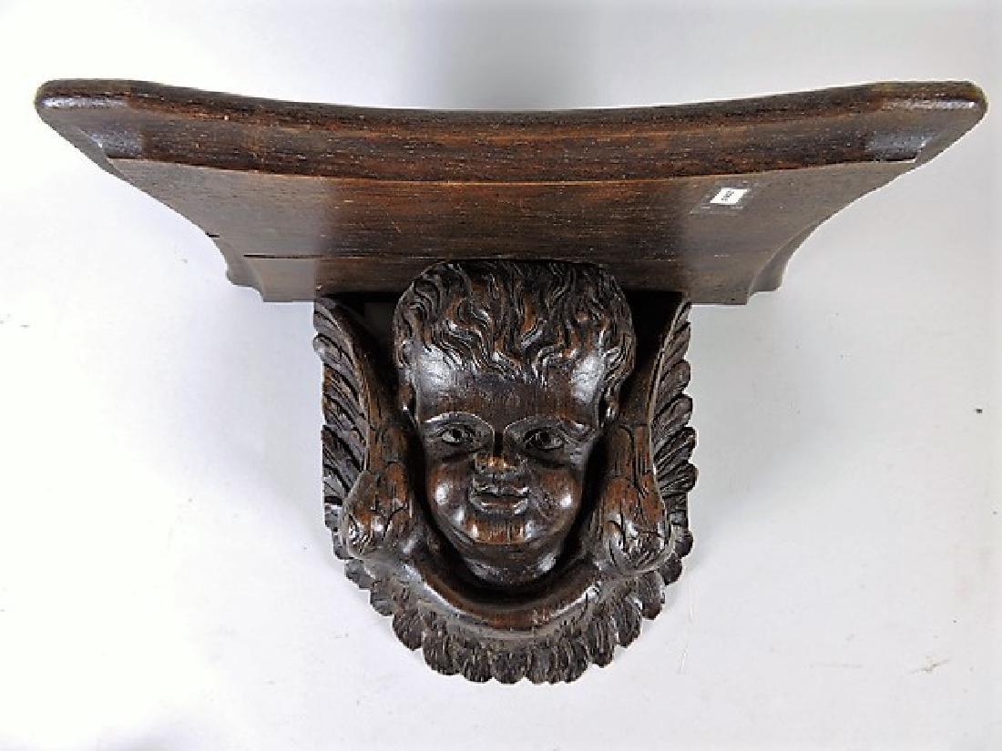 Black Forest carved wooden bracket shelf with angel,