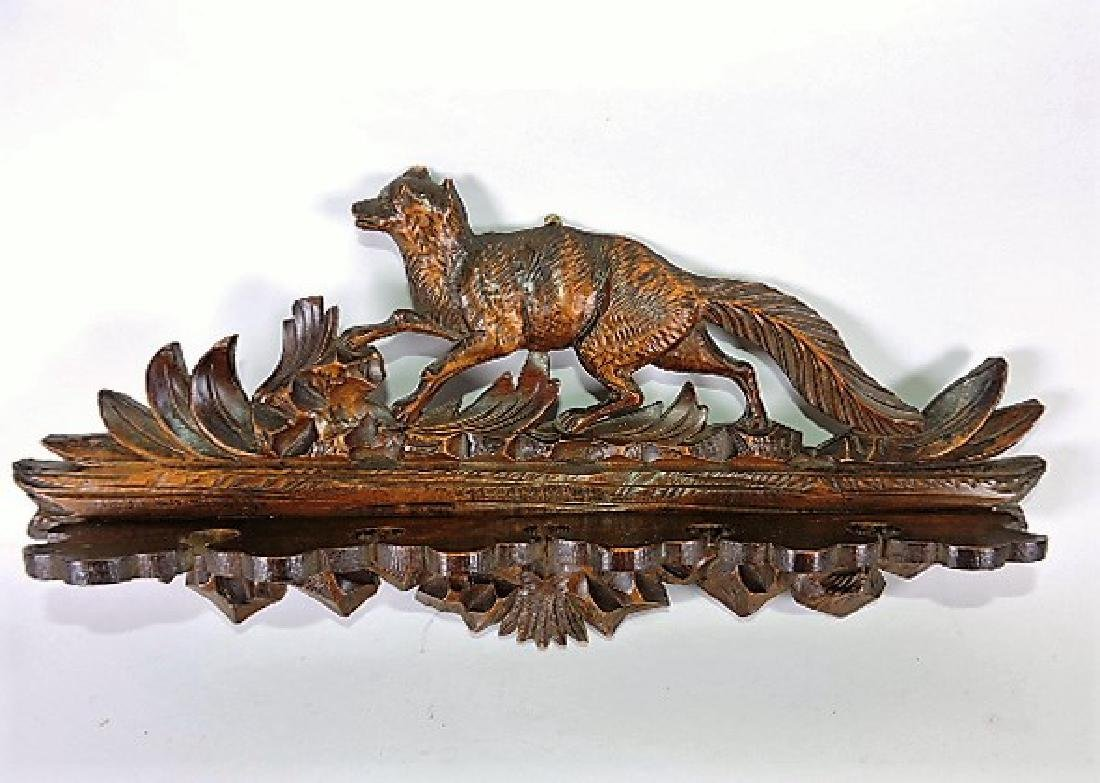 Black Forest carved wooden fox wall mounted pipe rack,