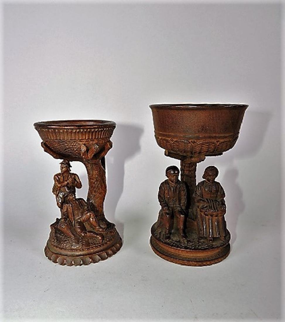 Black Forest carved wooden pair of cups, one with two