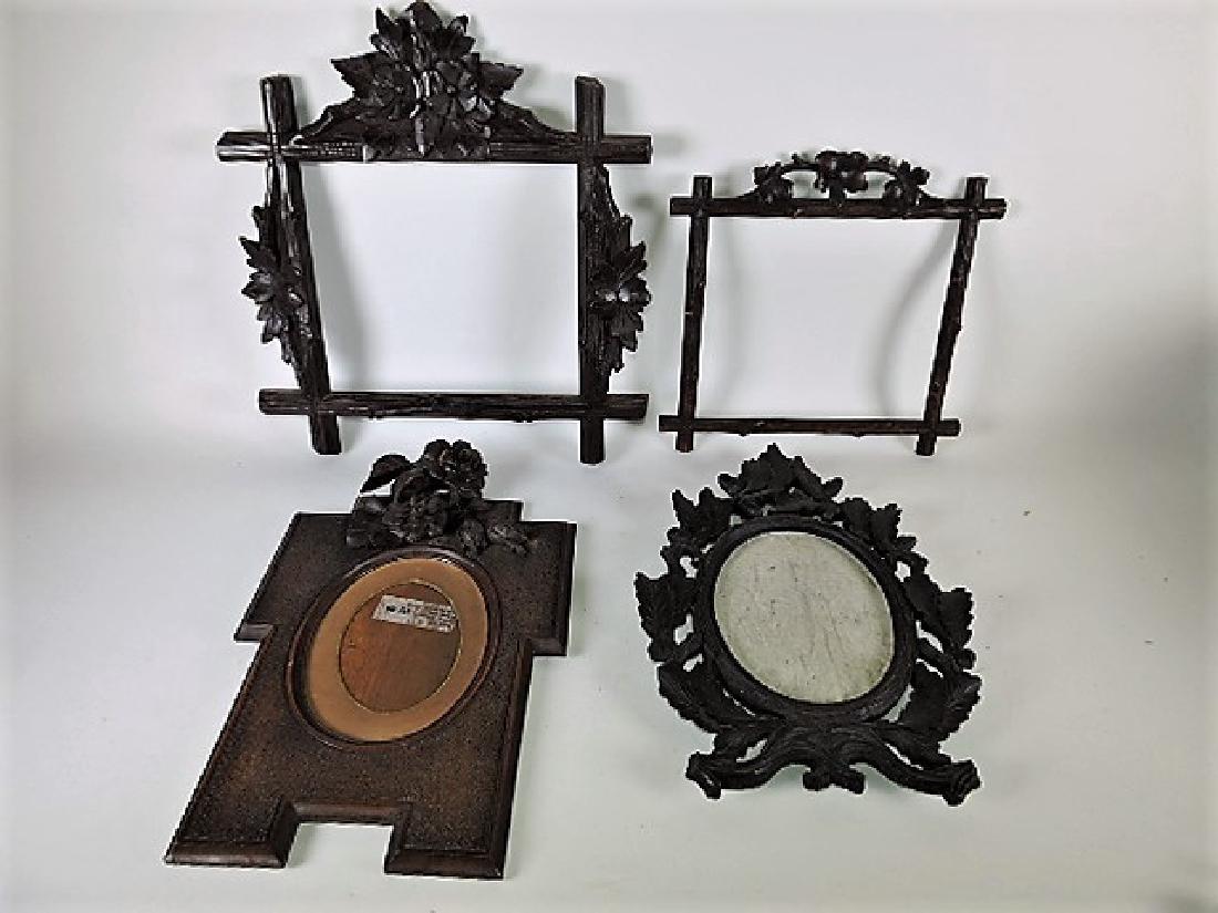 Black Forest carved wooden lot of 4 picture frames,