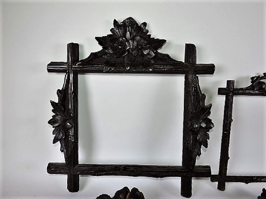 Black Forest carved wooden lot of 4 picture frames, - 4