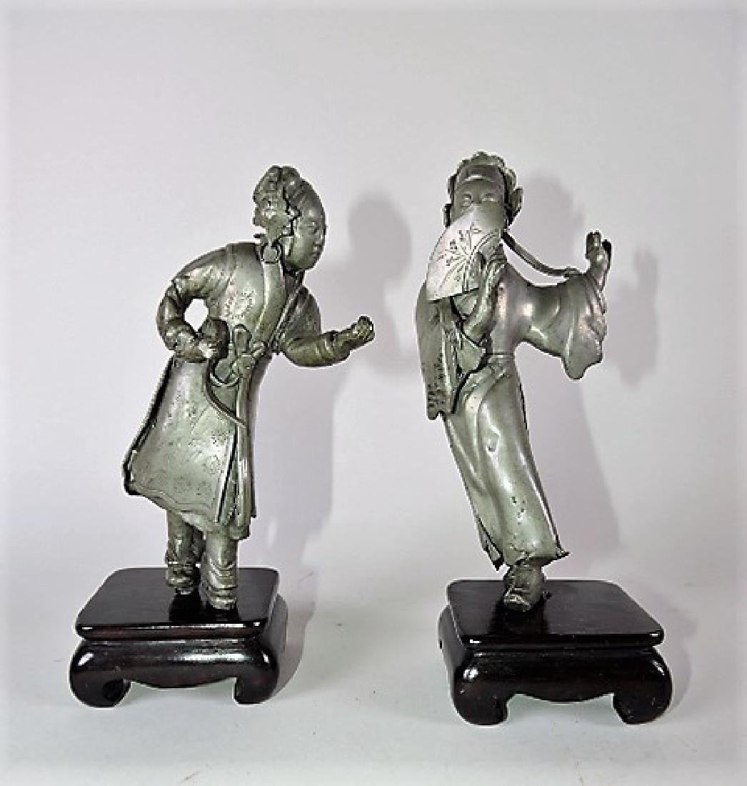 """Pair of pewter Oriental figures on teakwood stands 8"""""""