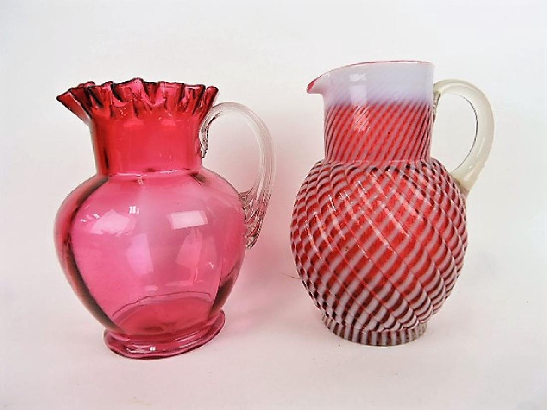 Cranberry water pitcher with clear ribbed handle