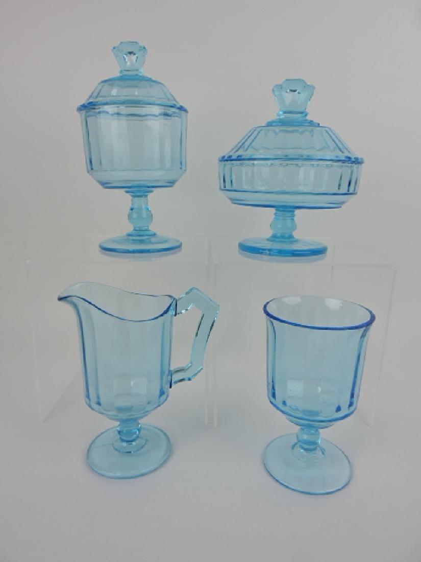 Blue 4 piece pattern glass table set, nicks to