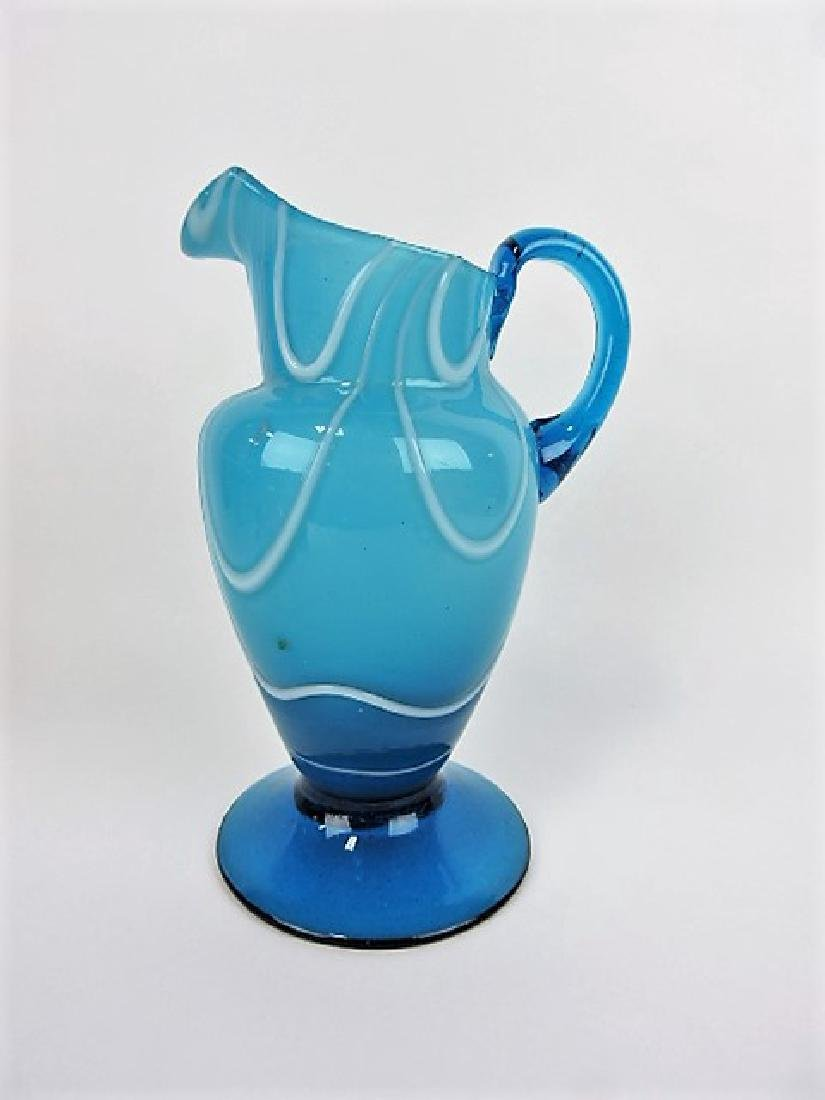 Blue blown glass pitcher, 9 3/4""