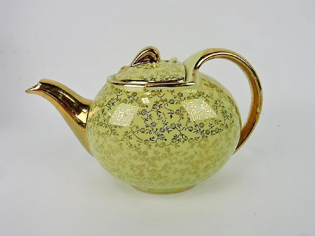 Hall China teapot, hook, yellow with gold