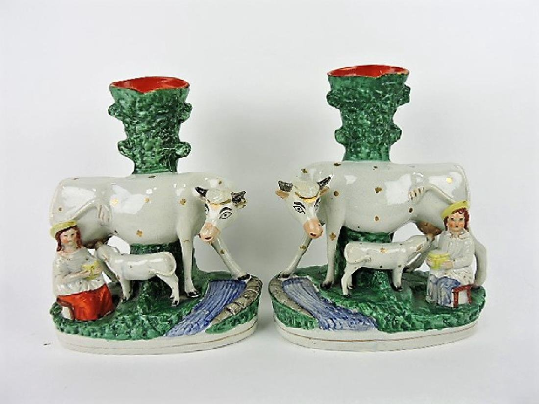 Staffordshire pair of cows with calf and milk maid