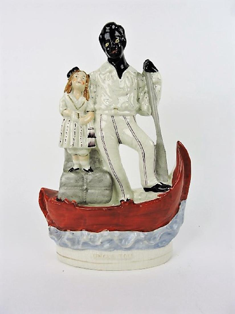 Staffordshire figure of Uncle Tom with Eve in boat