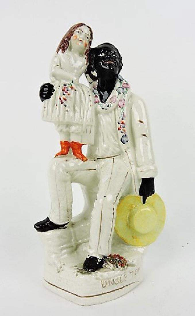 """Staffordshire figure of Uncle Tom with Eva, 11"""""""