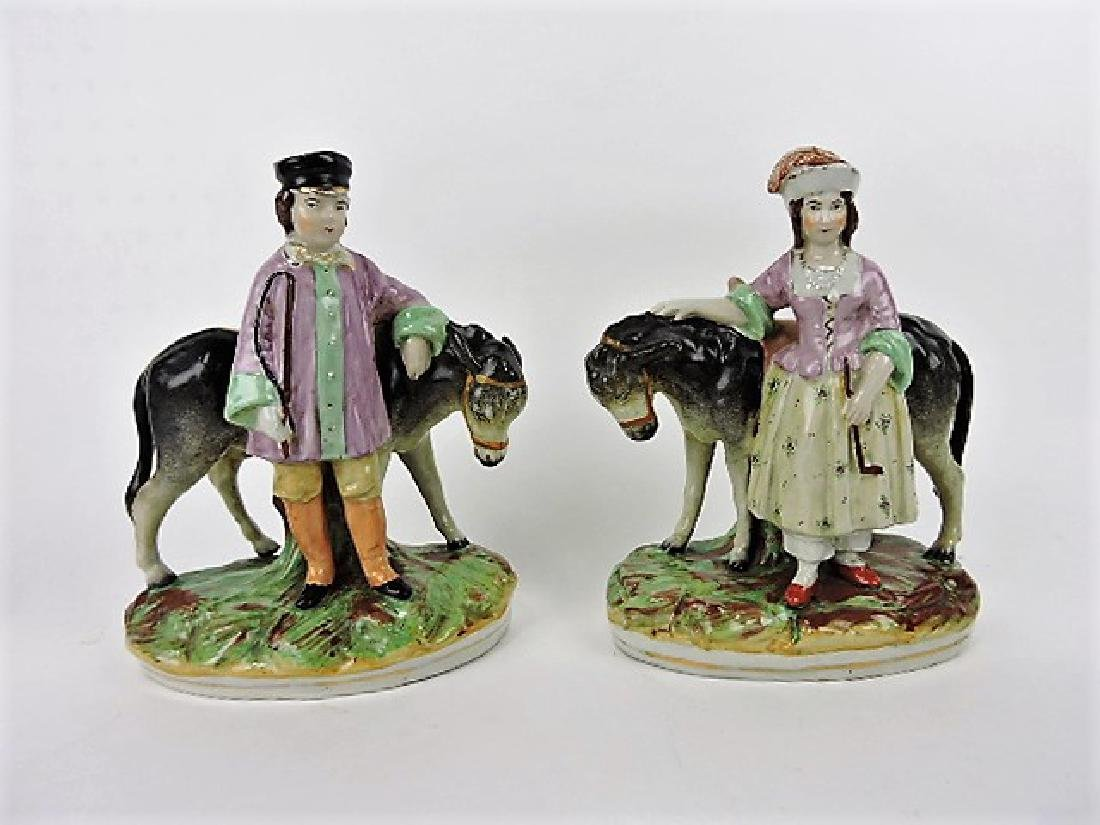 Staffordshire pair of figures of man and women,