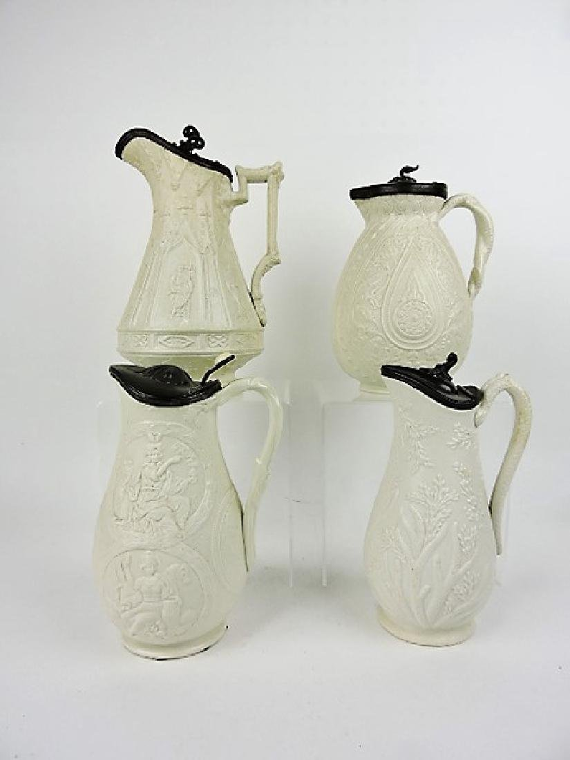 Parian lot of 4 molded jugs with pewter tops