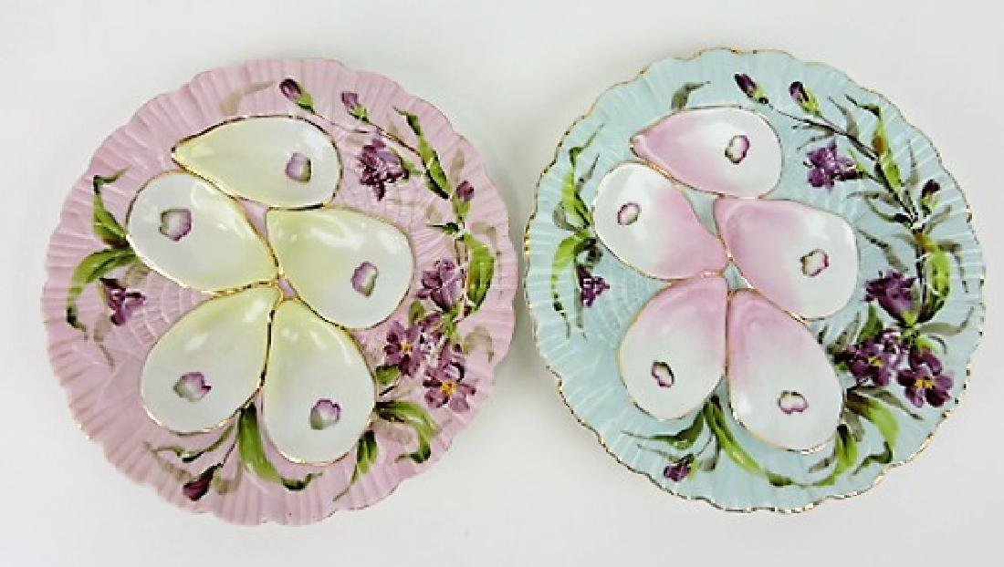 Porcelain pair of 5 well oyster plates, one