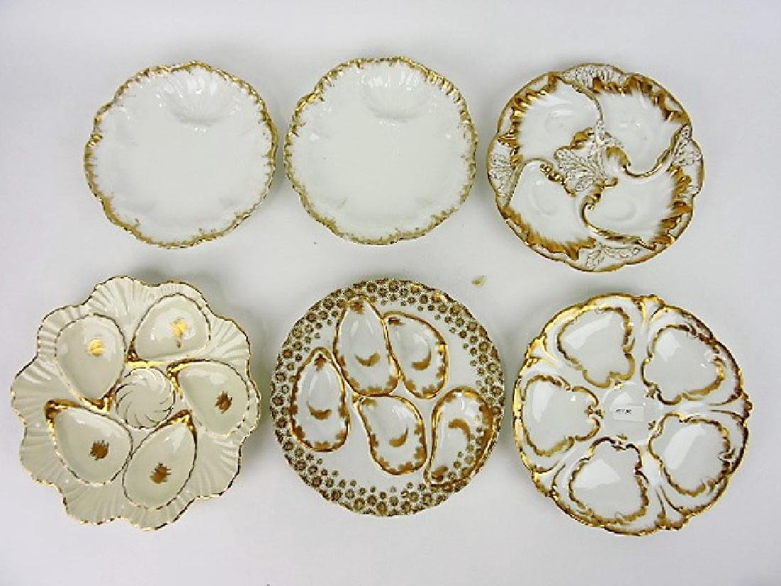 Lot of 6 porcelain oyster plates with gold decor