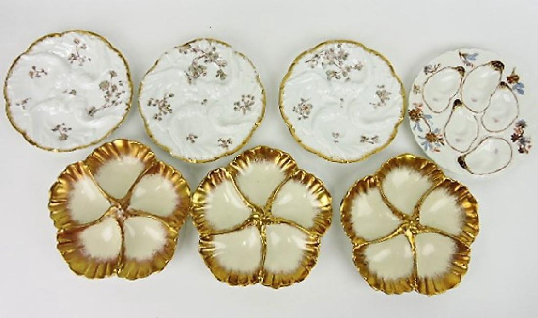 Lot of 7 porcelain oyster plates, Haviland and