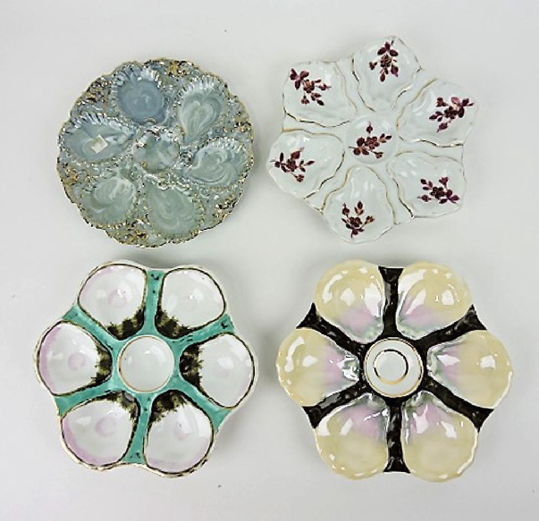 Lot of 4 porcelain oyster plates