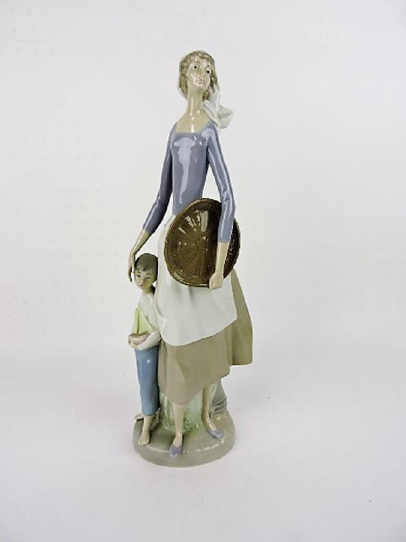 Lladro figure of lady with child, 16""