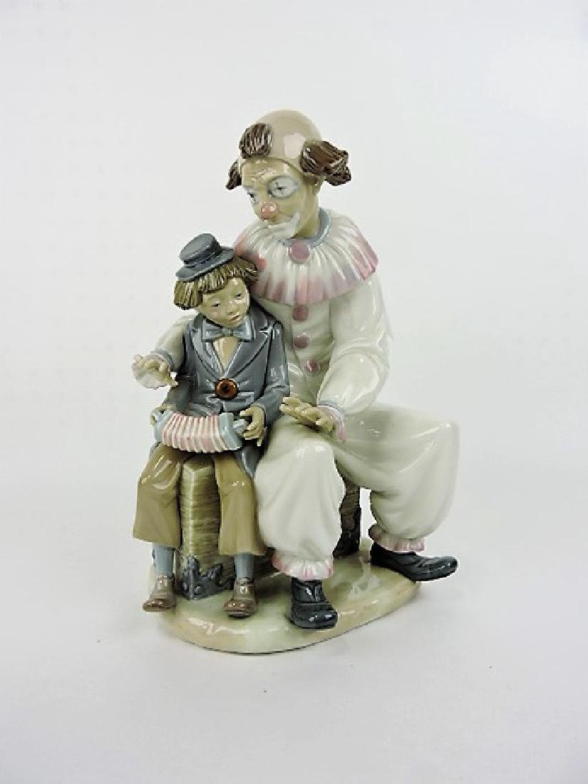 Lladro figure of clown with boy, 11""