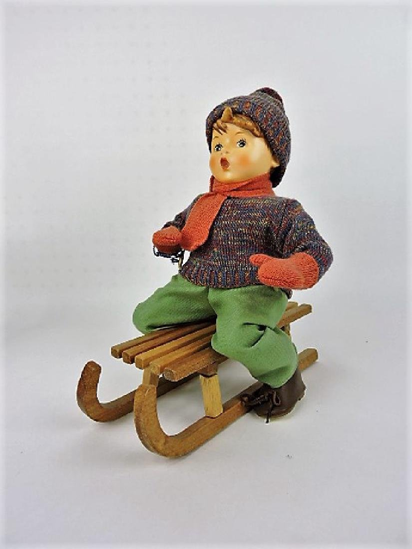 Hummel boy on sled