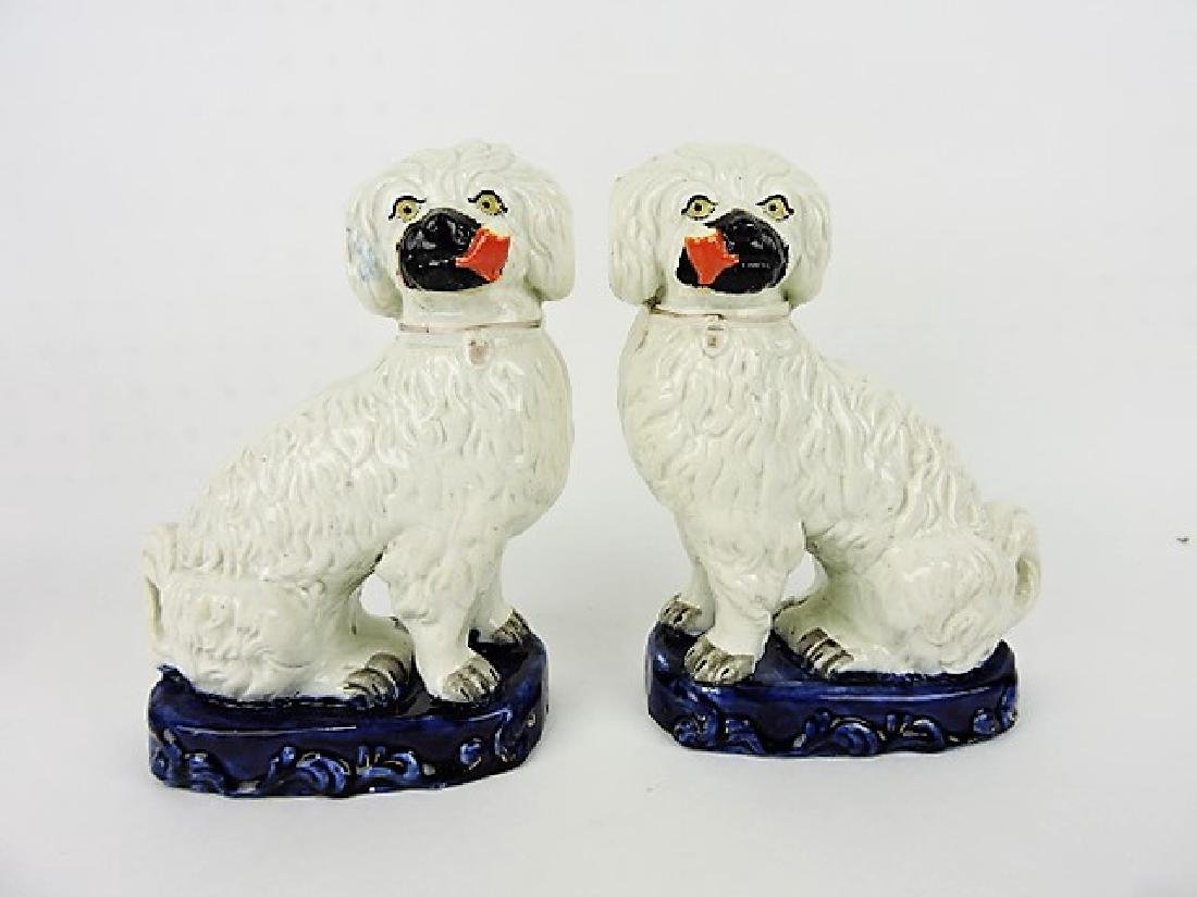 Staffordshire pair of smoking spaniels on blue