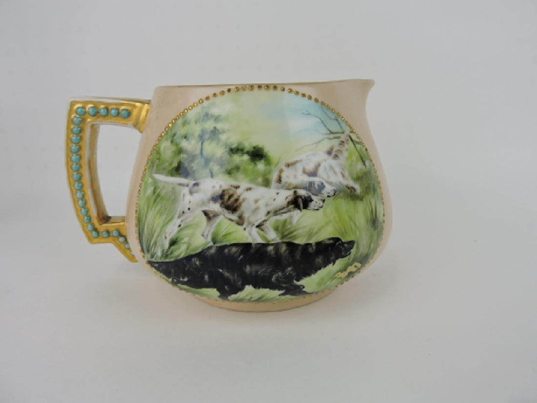 Limoges lemonade pitcher with hunting dogs, wear