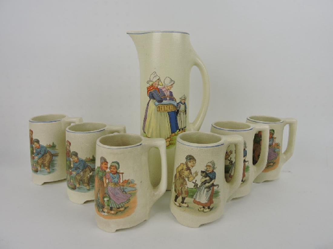 Roseville Dutch tankard and 6 mugs