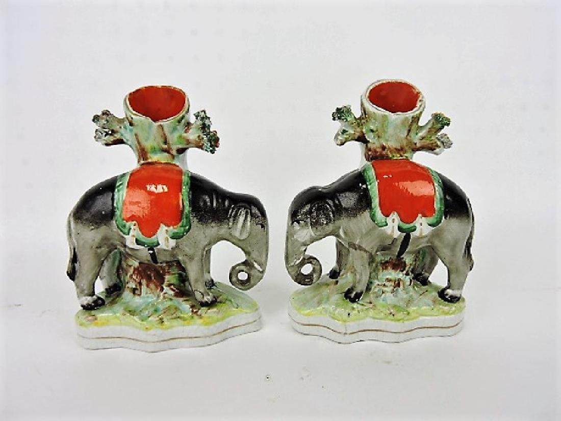 Staffordshire pair of spill vases with elephants,