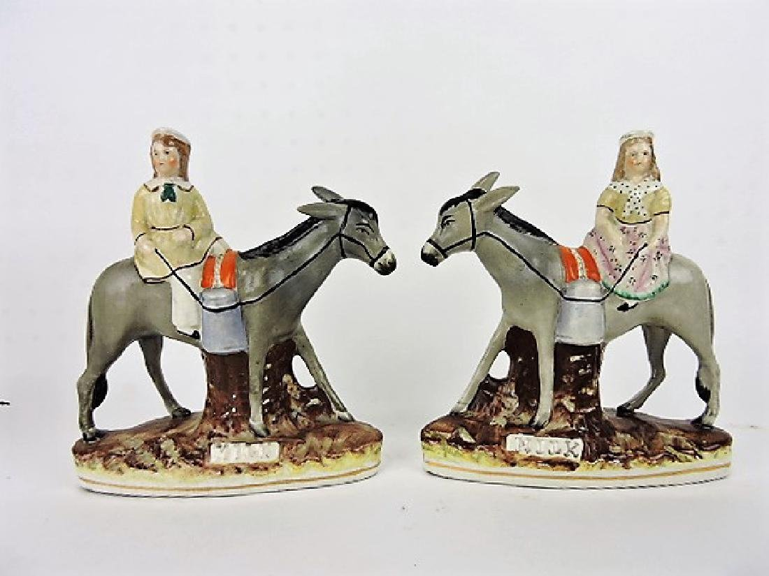 Staffordshire Pearlware pair of figures of boy and