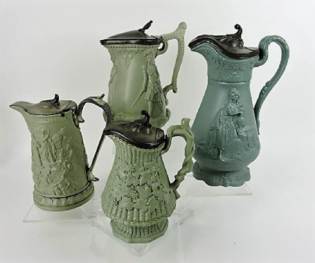 Green parian/stoneware lot of 4 molded jugs with