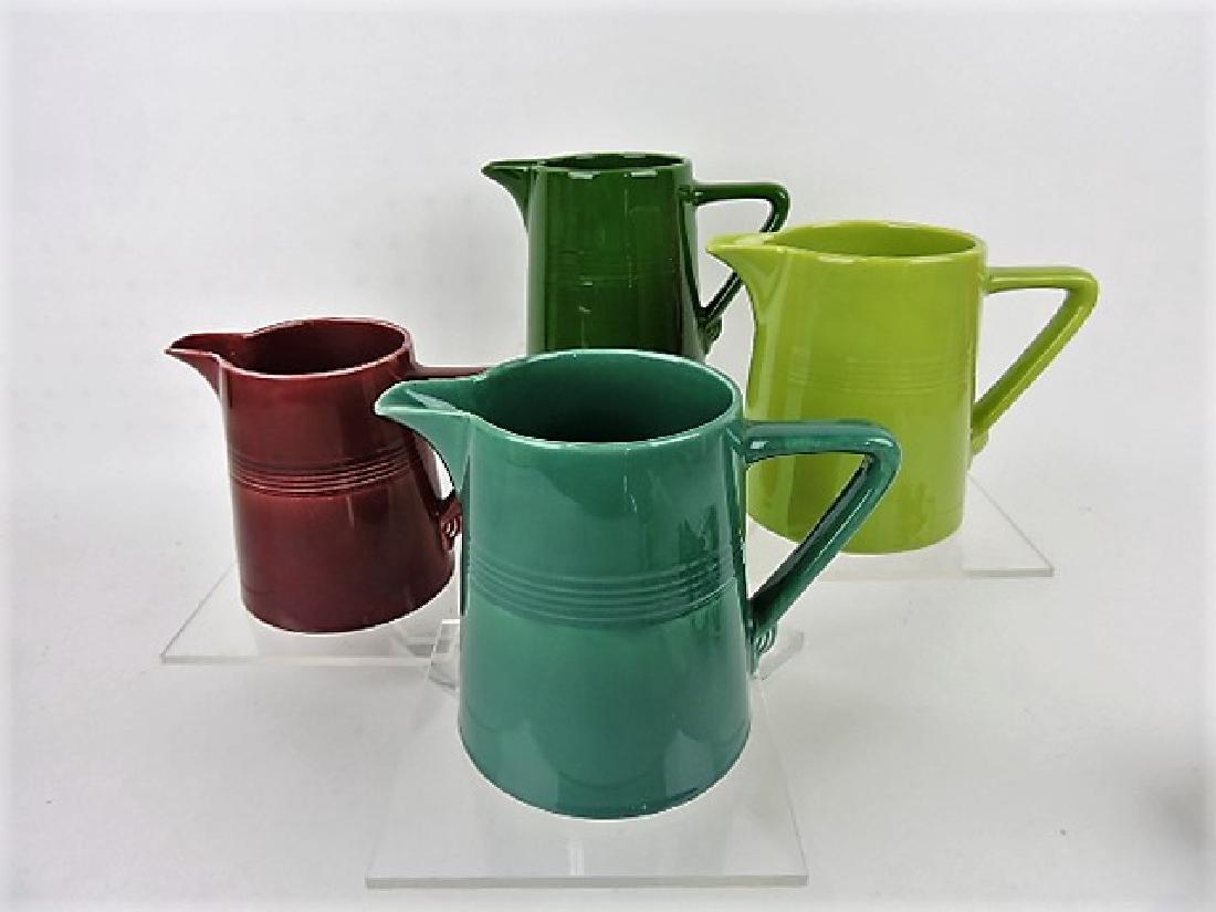 Fiesta Harlequin, lot of 4- 22oz jugs-dark green,