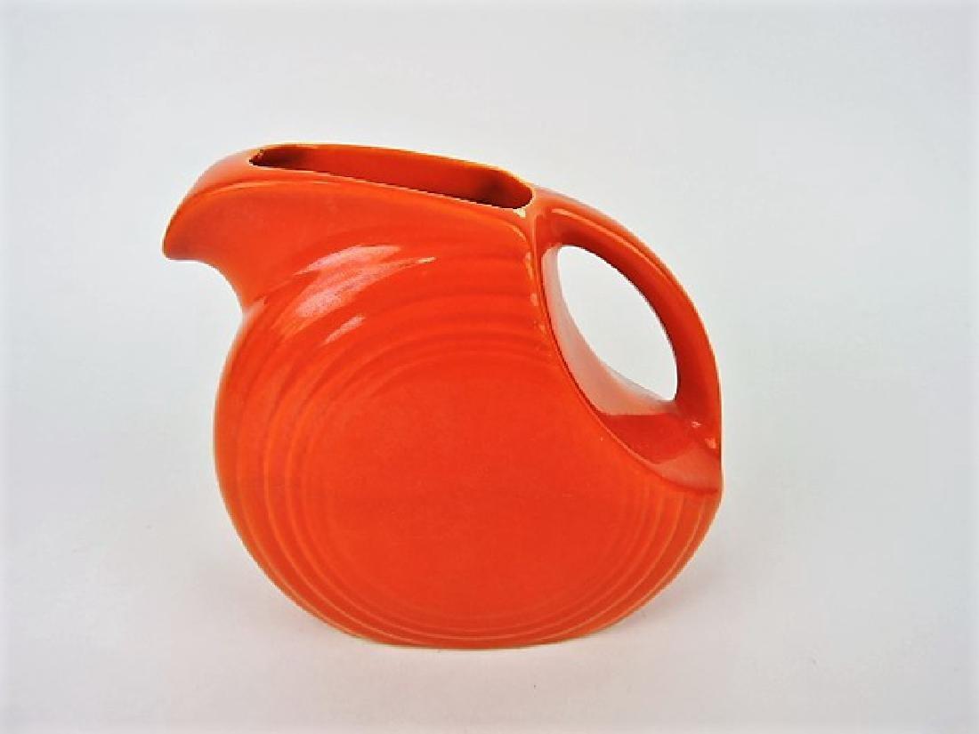 Fiesta disk juice pitcher, red, nicks