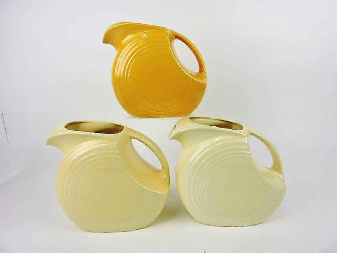 Fiesta disk water pitcher group-yellow and 2 ivory