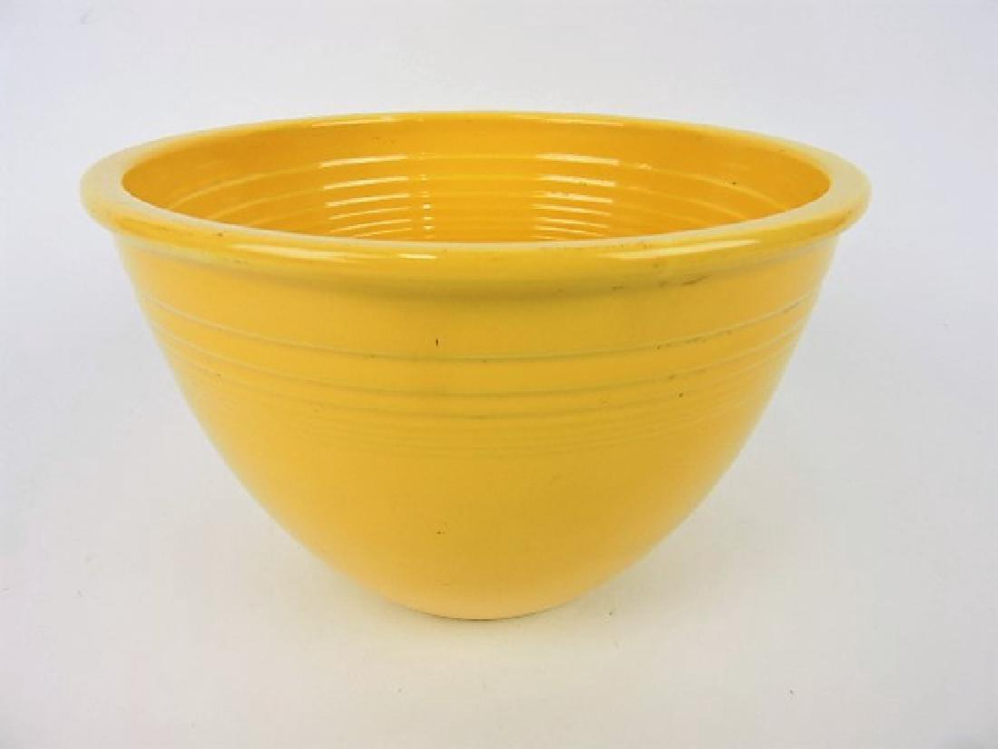 Fiesta #5 mixing bowl, yellow, nick