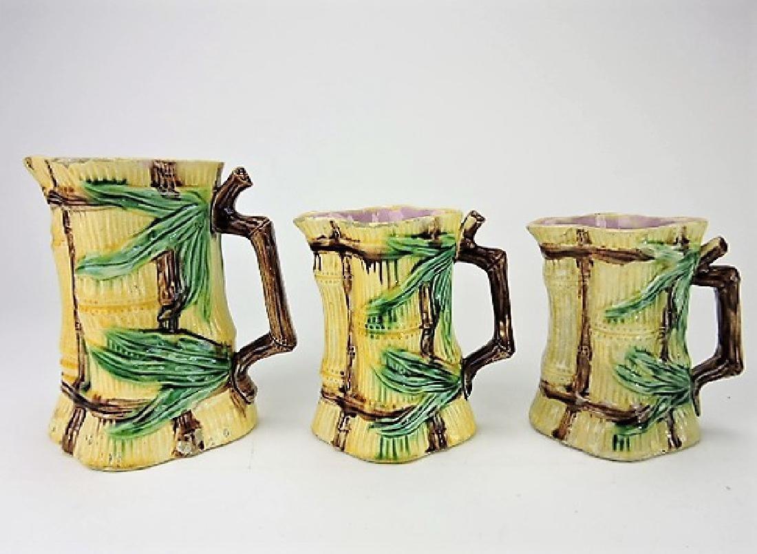 Majolica set of 3 graduated bamboo pitchers,