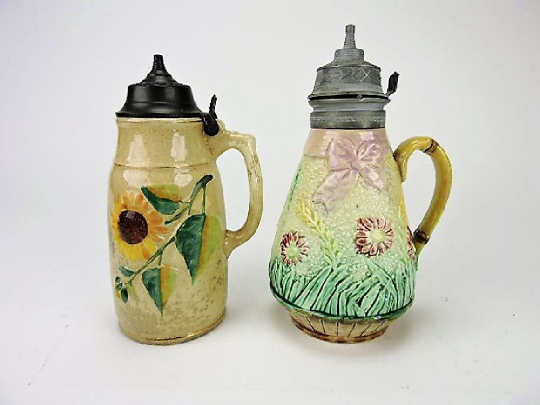 Majolica lot of 2 syrup pitchers