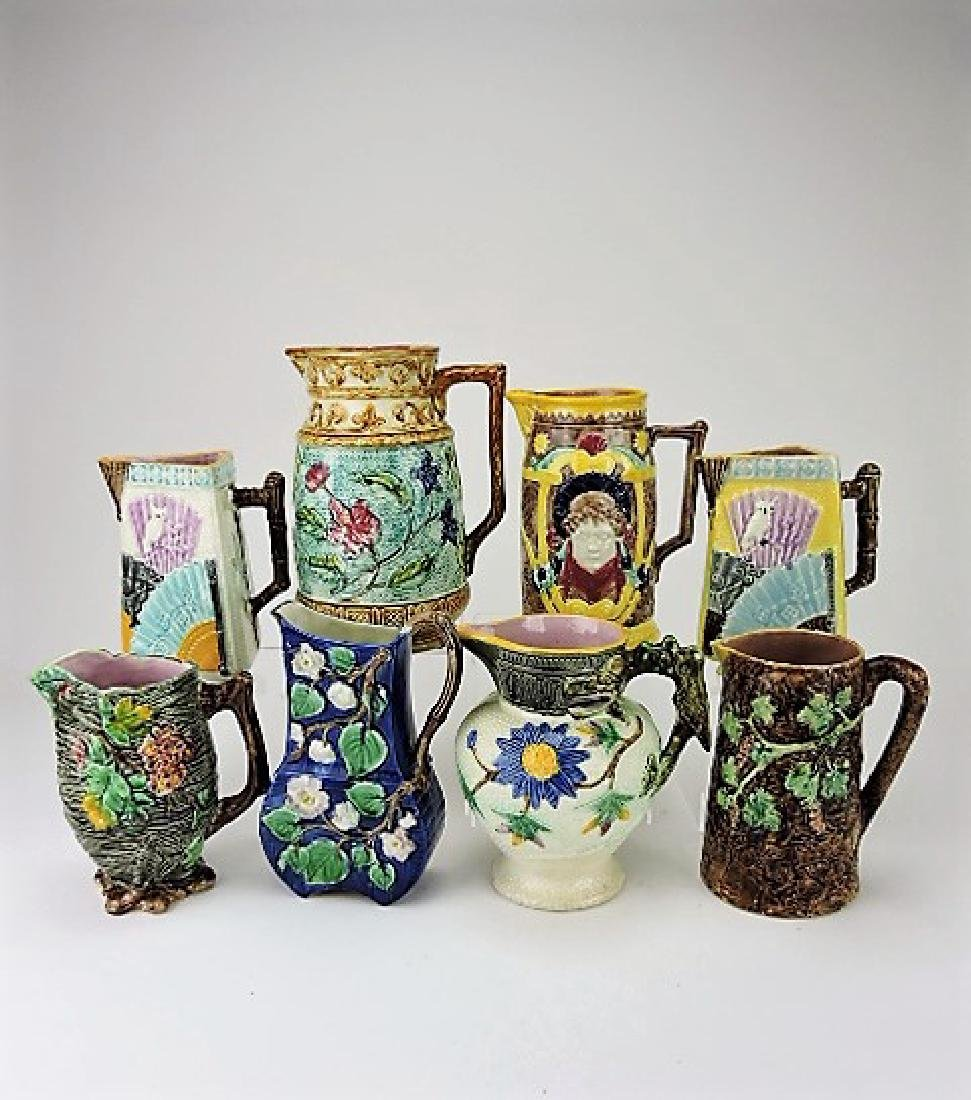 """Majolica lot of 8 pitchers, 8"""" to 10"""", various"""