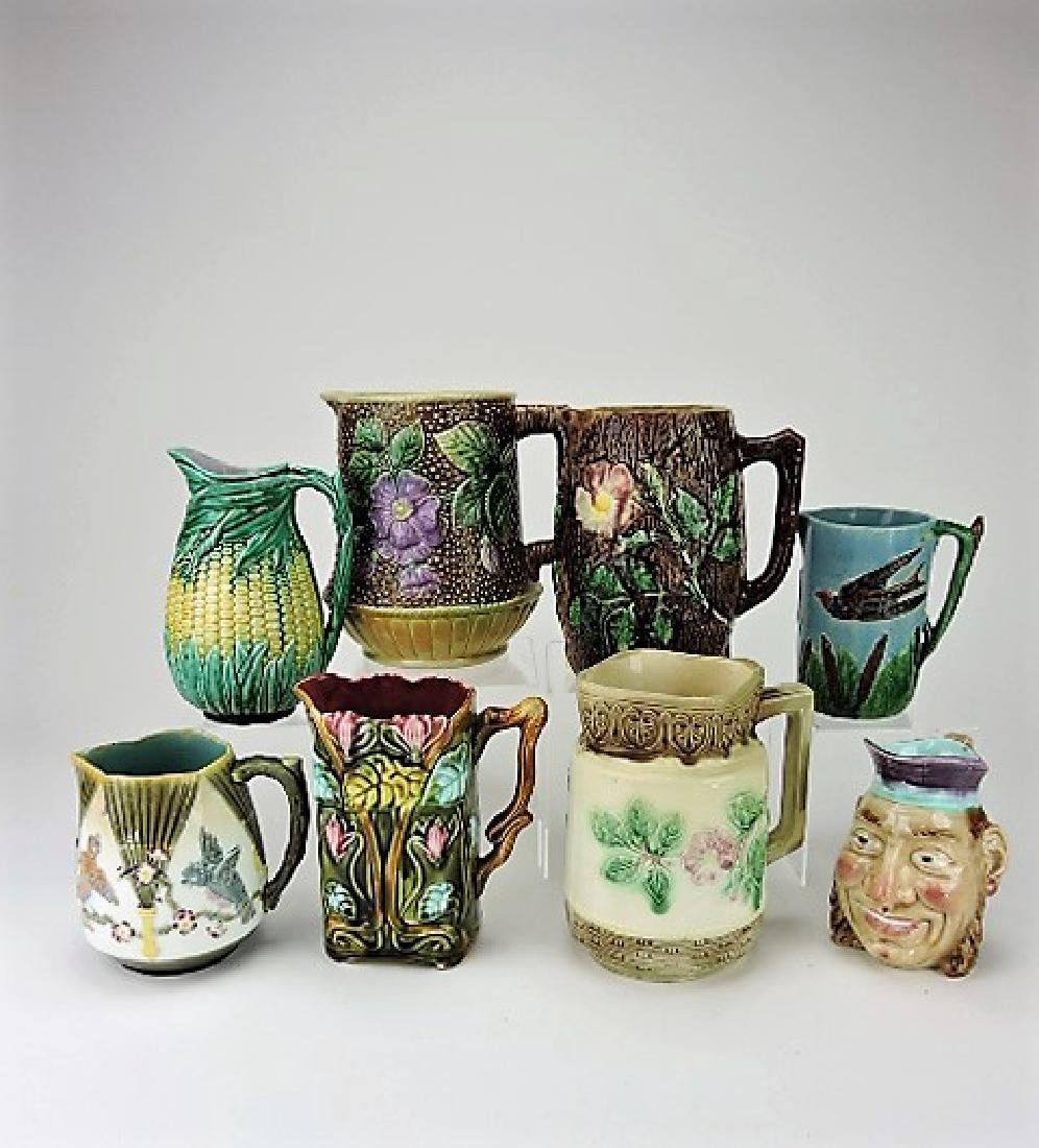 """Majolica lot of 8 pitchers, 6"""" to 9"""", various"""
