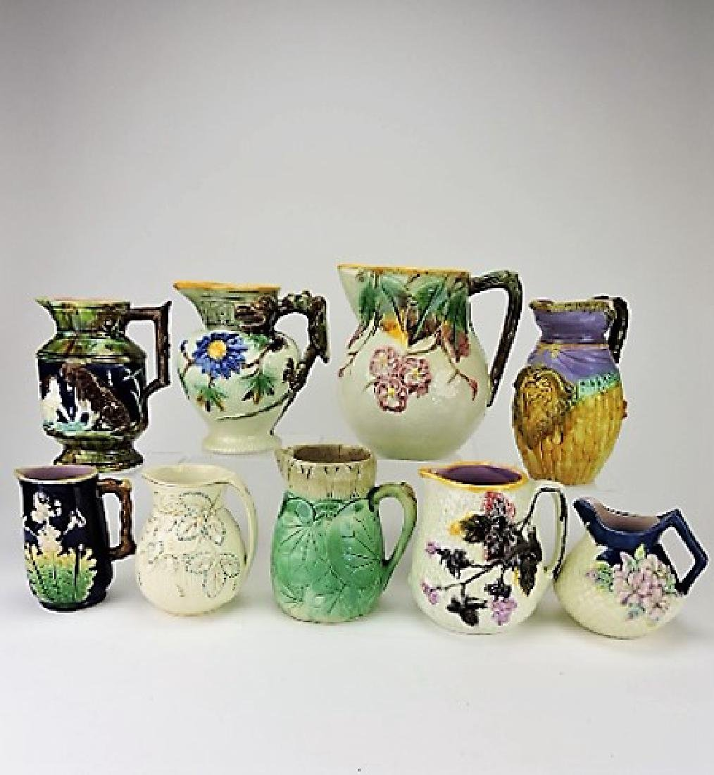 "Majolica lot of 9 pitchers, 6"" to 9"", various"
