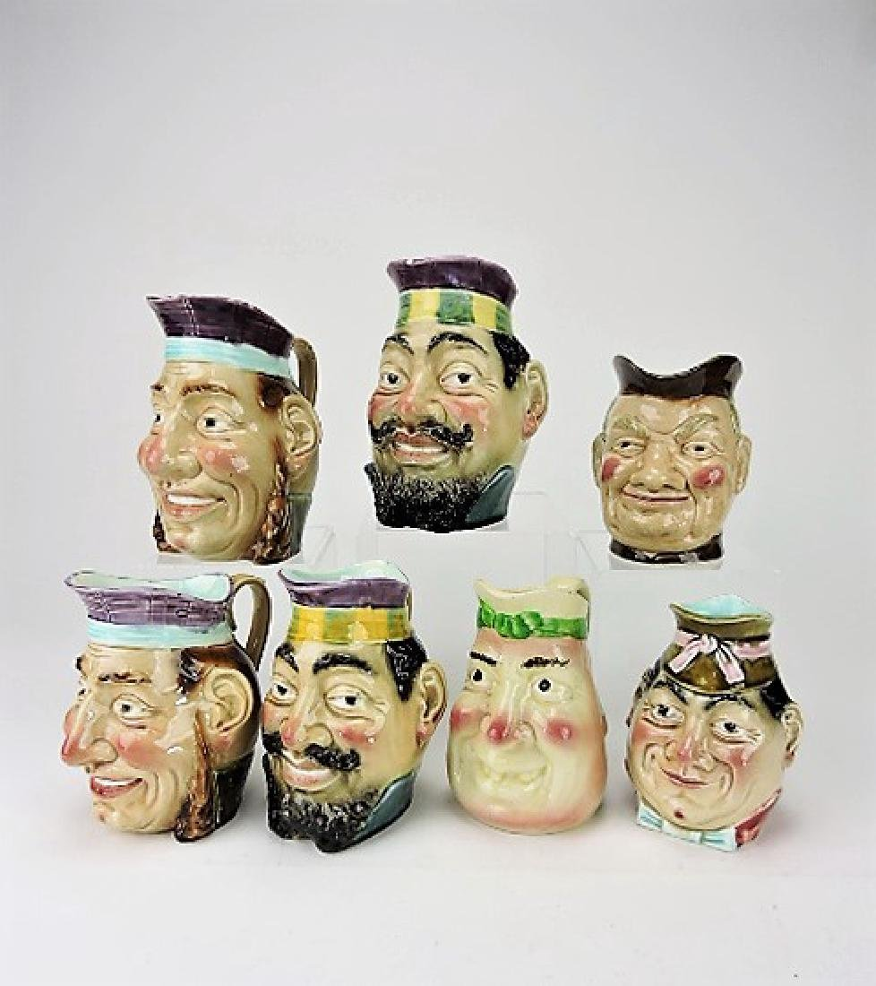 Majolica lot of 7 face jugs, various condition