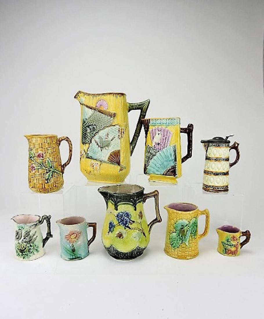 Majolica lot of 9 pitchers and creamer