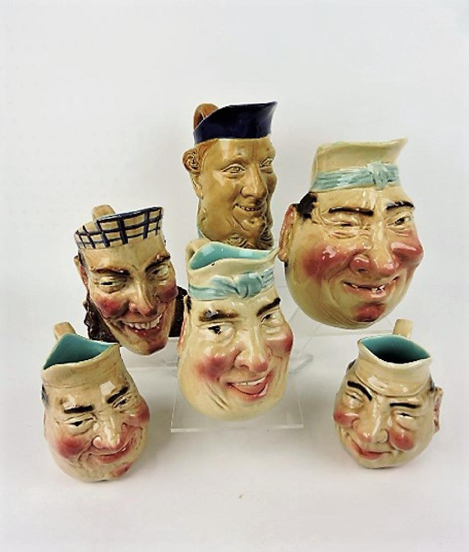 Sarreguemines majolica lot of 4 face jugs, various