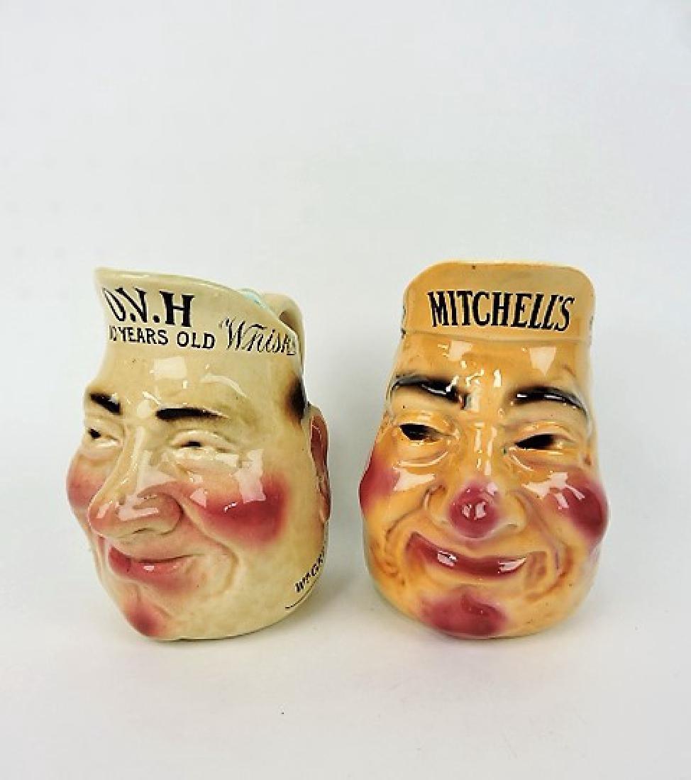 Majolica lot of 2 advertising face jugs