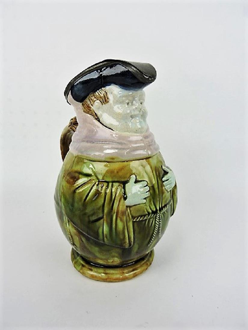 Majolica toby jug with pewter top