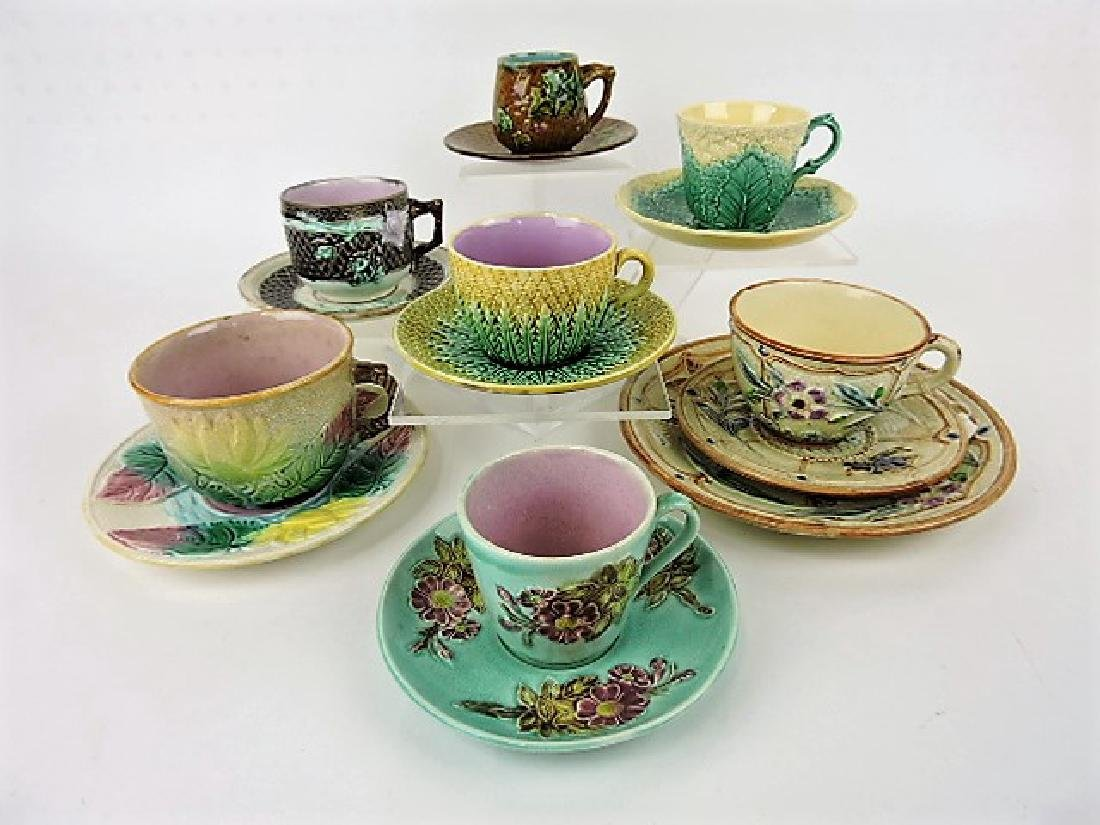 Majolica lot of 7 cups & saucers, various