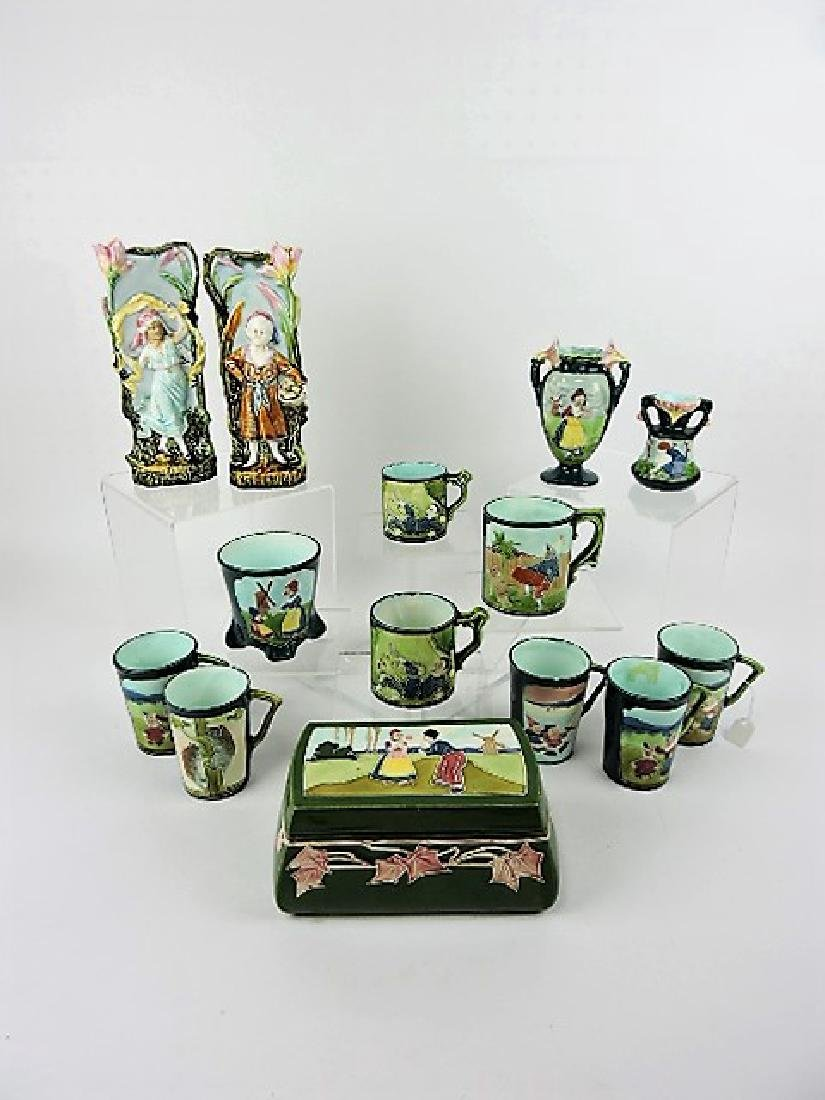 Majolica lot of 14 assorted vases, mugs, and