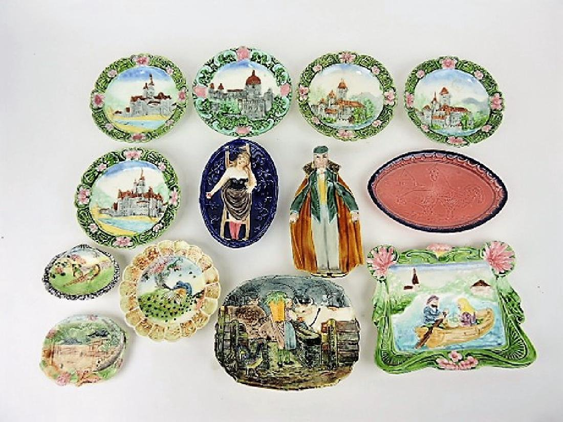 Majolica lot of 13 scenic plates and trays,
