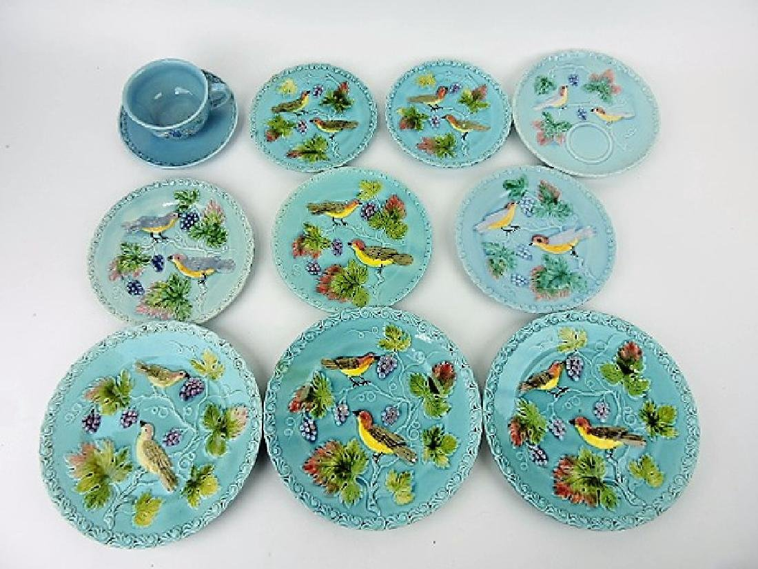 Majolica lot of 9 plates and cup/saucer, various