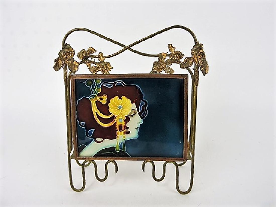 Majolica tile in brass frame of Art Nouveau lady,