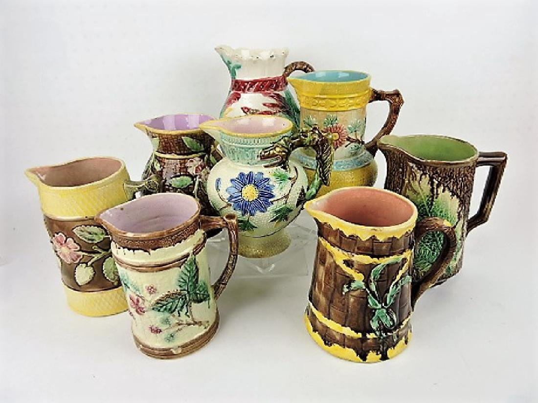 Majolica lot of  8 pitchers, various condition